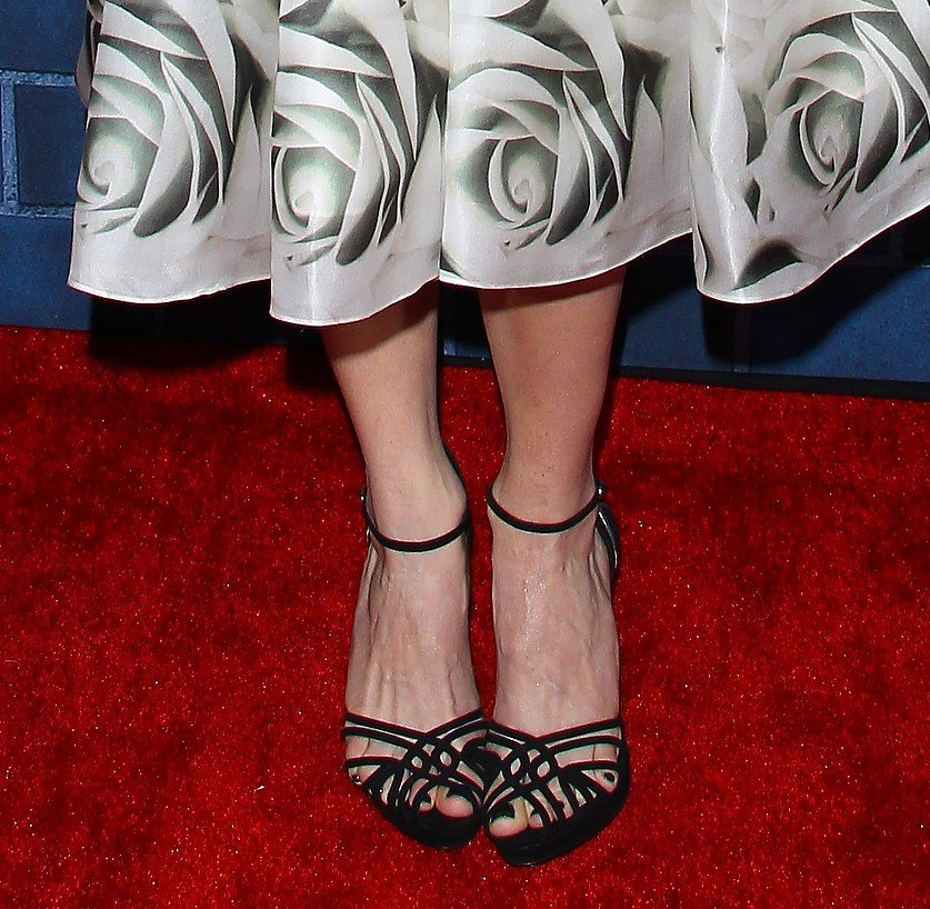 Emmy Rossum's ladylike dress got an edgy finish thanks to her black strappy sandals at the Montblanc and UNICEF brunch.