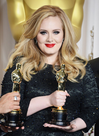 Adele Let's Her Hair Down and Dons Red Lips