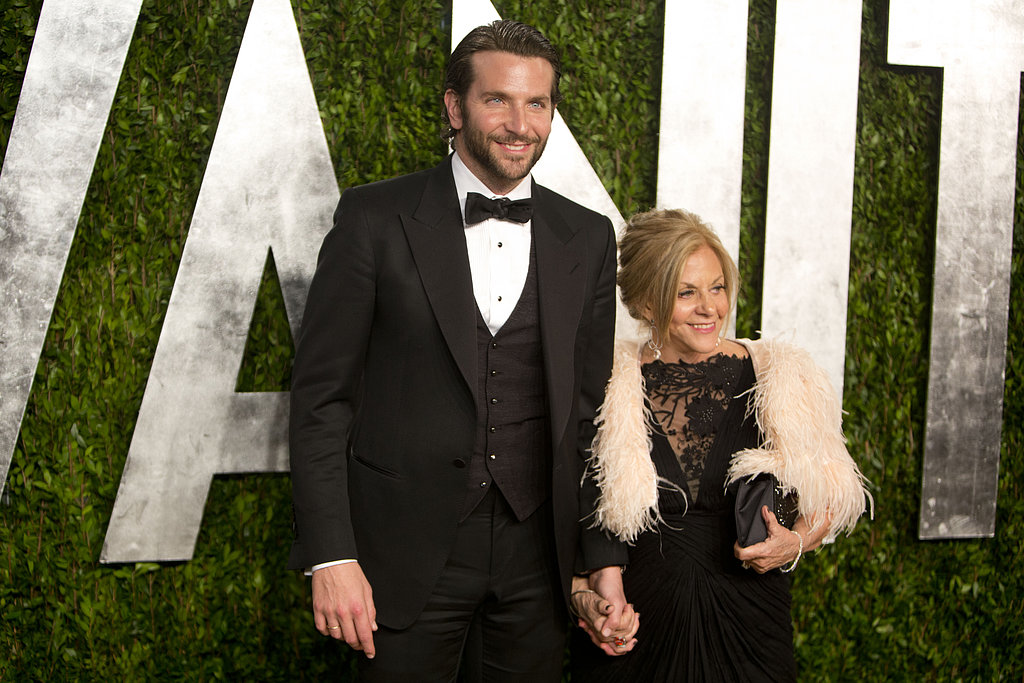 Bradley Cooper was hand in hand with his mom, Gloria, as he arrived at the Vanity Fair Oscar party on Sunday night in LA.