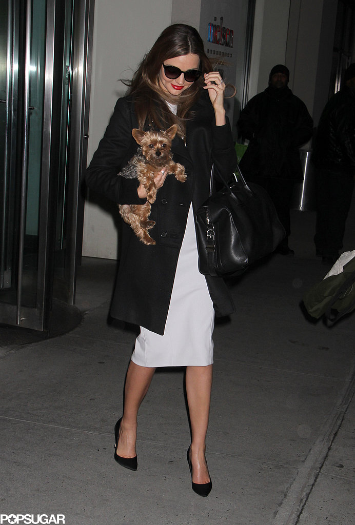 Miranda Kerr carried Frankie out of a building.