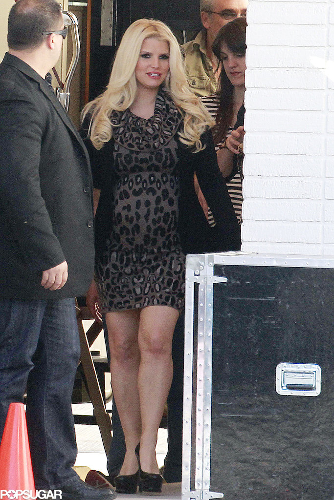 Jessica Simpson wore a leopard dress on set.