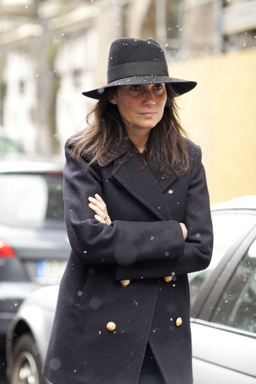Emmanuelle Alt showed off her signature style in a military coat and a fedora.
