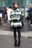 Miroslava Duma worked the punky schoolgirl angle in a plaid mini, specs, and an oversize belt.