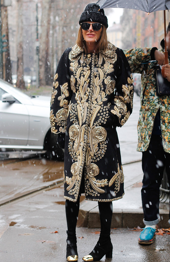 Anna Dello Russo dressed the part of fashion royalty in a gilded coat and gold-capped boots.