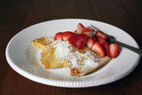 Channel your inner Julia Child with this buttery crepes fines sucrées recipe with strawberries marinated in orange liqueur.