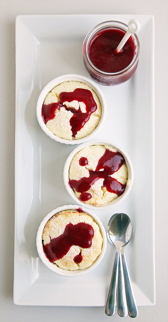 Spice up a standard lemon soufflé recipe with tangy raspberry coulis.