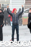 Andrew Garfield raised his arms over his head while on the set of The Amazing Spider-Man 2 in NYC.