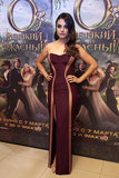 MIla Kunis wore a burgundy gown.