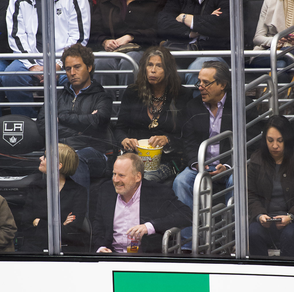 Steven Tyler ate popcorn in the stands at the Kings game.