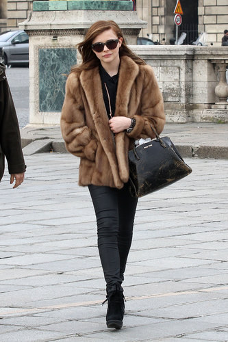 Chloë Moretz wore a fur coat as she made her way to a fashion show during Paris Fashion Week in February.