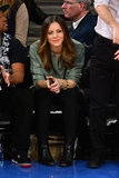 Katharine McPhee worked her all-black bottoms with an army-green button-down and a bevy of gold bangles at the New York Knicks game in NYC.