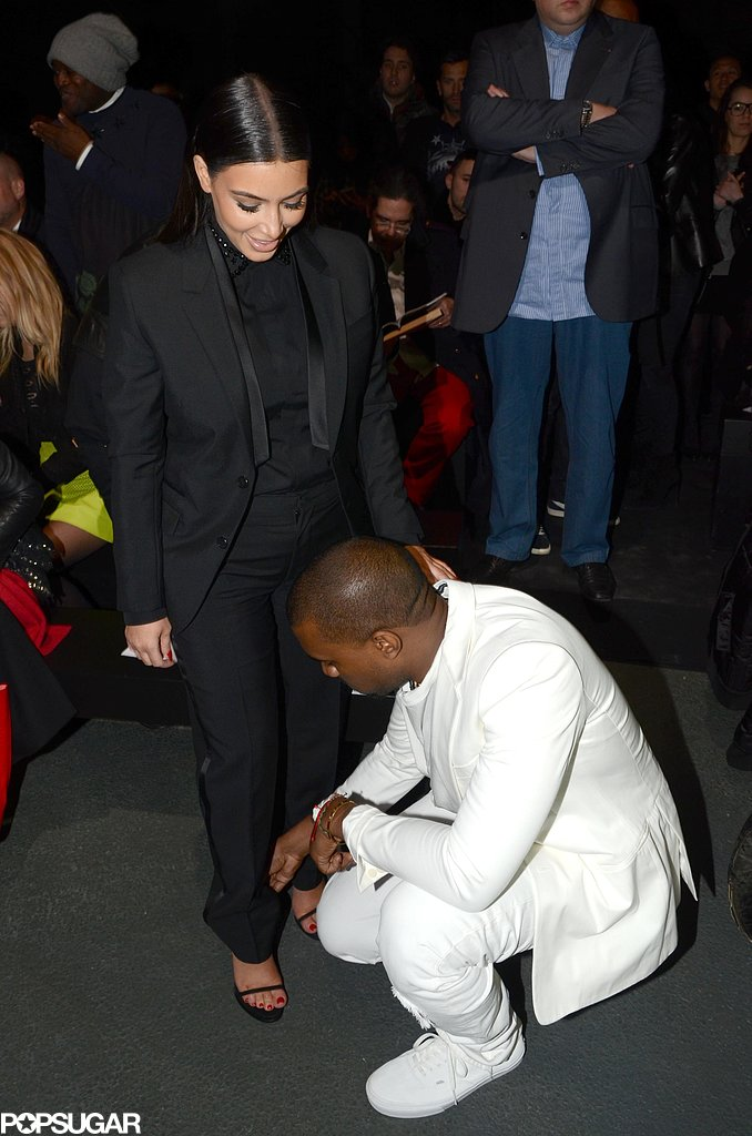 Kanye helped Kim with her shoe after attending a Givenchy show together in Paris in March 2013.