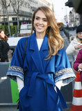 Jessica Alba was bright in blue at Kenzo's show on Sunday.