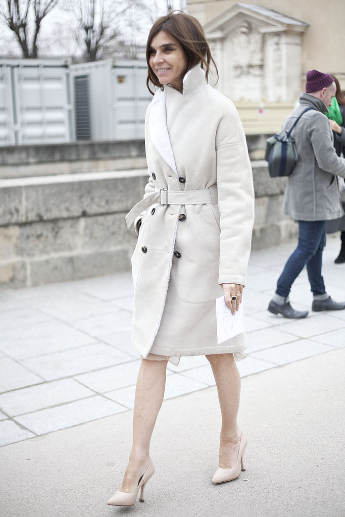 Carine Roitfeld arrived in a creamy coat and nude pumps.