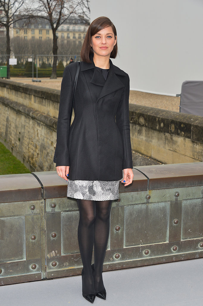 Marion Cotillard looked picture-perfect in a structured black coat and matching pumps, complete with a brilliant blue manicure, while arriving to the Christian Dior show during PFW.