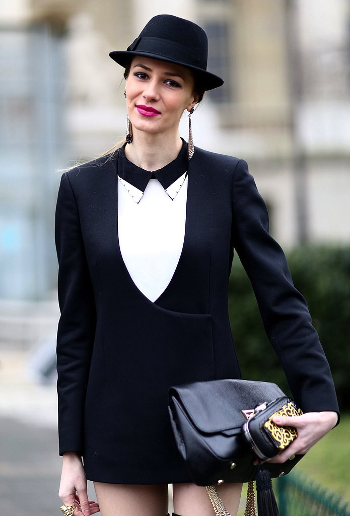 A fedora, statement silver earring, and two luxe bags added major flourish to this menswear-inspired outfit.