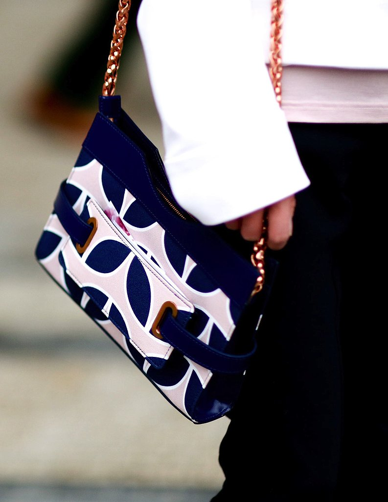 Check out the fun navy and light-pink graphic print on this chain-handled bag.