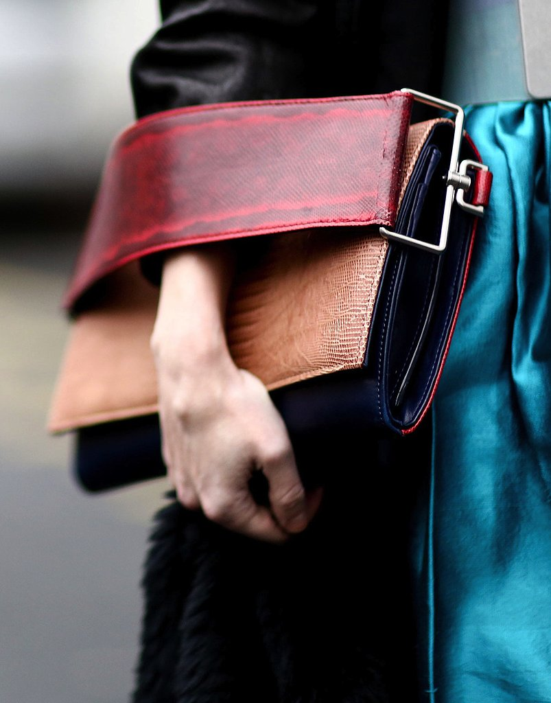 We can't get enough of the bold arm strap on this colorblocked clutch.
