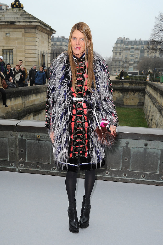 Anna Dello Russo doubled up on fur with a black and blue vest and colour-blocked handbag at Christian Dior.