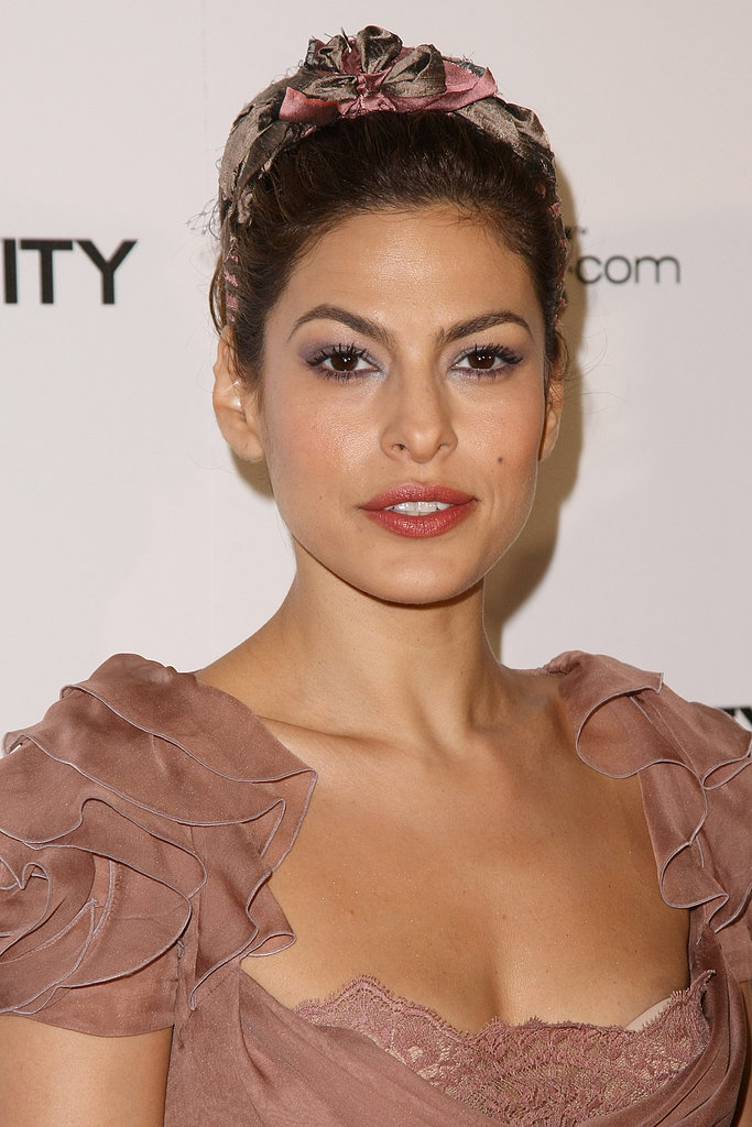 At the 2011 Art of Elysium Heaven Gala, Eva Mendes wore a palette of pinks and purples, including a matching scarf in her hair.