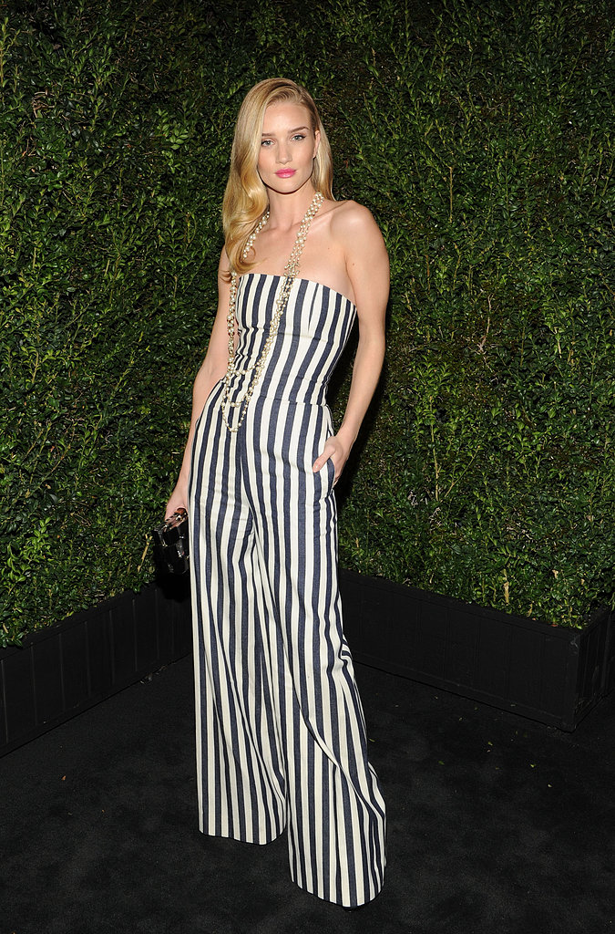 Rosie Huntington-Whiteley looked funky in a black and white striped strapless jumpsuit at the Chanel pre-Oscar dinner in LA.