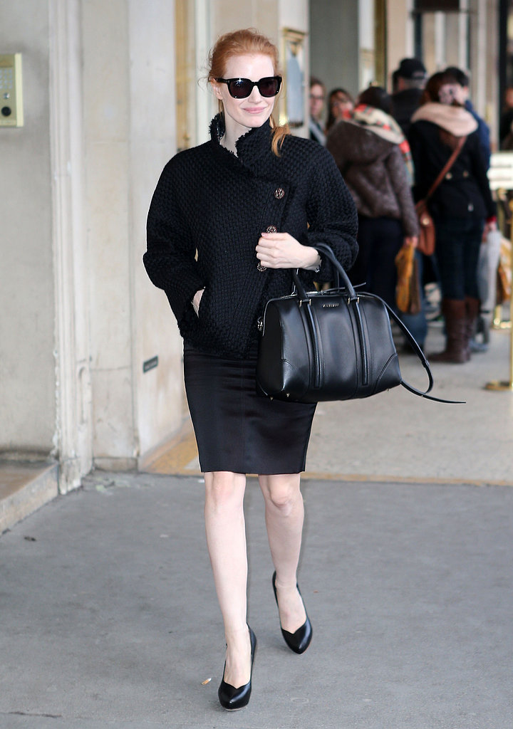 While strolling the streets of Paris, Jessica Chastain was sophisticated in all-black: a tweed jacket, pencil skirt, classic pumps, Givenchy bag, and dark sunglasses.