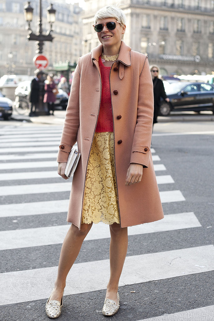 Elisa Nalin tempered a lacy dress with a knit, classic coat, and studded loafers.