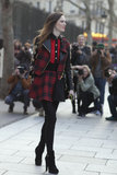 Coco Rocha hit the streets in punk-girl plaid.