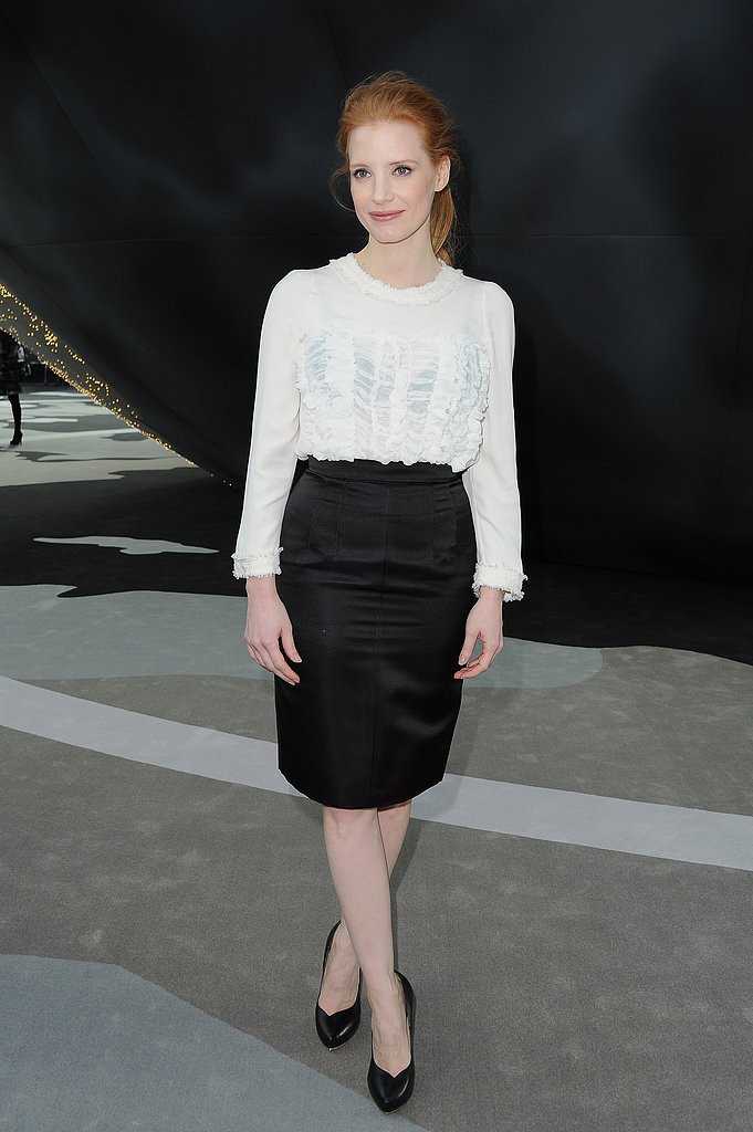 Jessica Chastain chose a black and white palette for Chanel's show at PFW. She tucked a ruffly white blouse into a silky black pencil skirt, then finished off with classic black pumps.