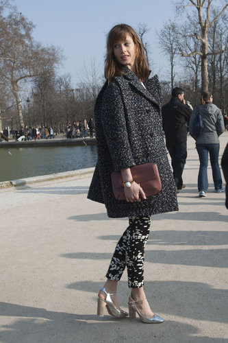 The textural play between her coat and trousers was a chic combo unto itself; the footwear just furthered the appeal.