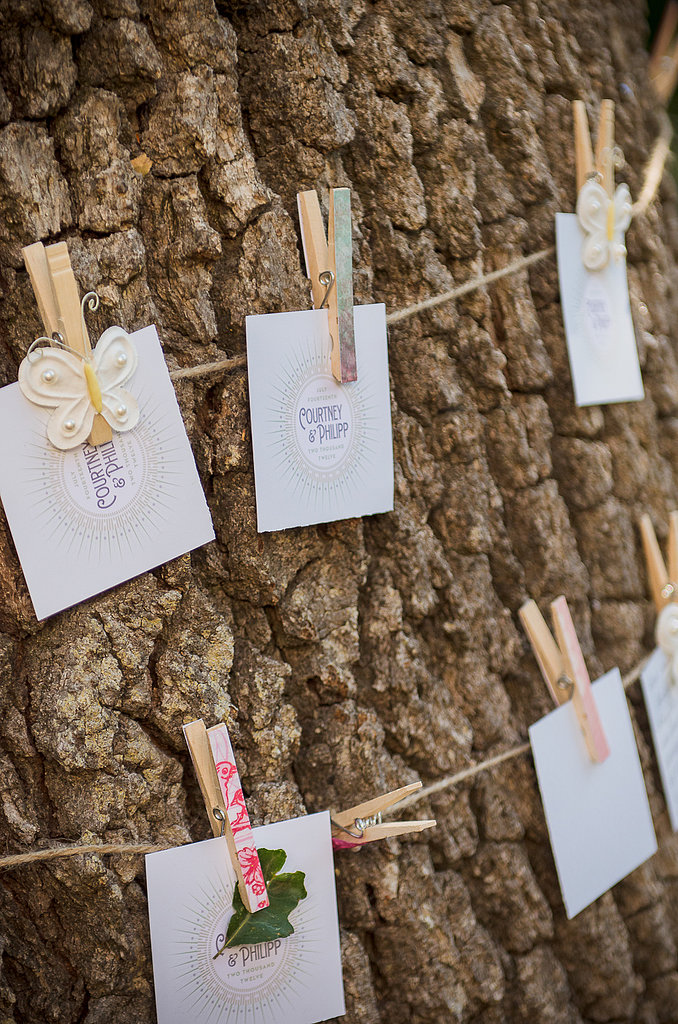 The couple added their own touch with leftover invitation stock and asked the guests at the reception to write down what love means to them. Source: Juliette Tinnus