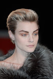 John Paul Gaultier thinks that all you need are bold brows and a hint of taupe on your lids.