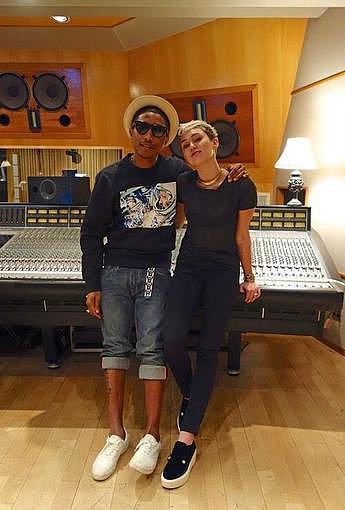 Miley Cyrus shared a photo of herself in the recording studio with Pharrell Williams. Source: Twitter user MileyCyrus