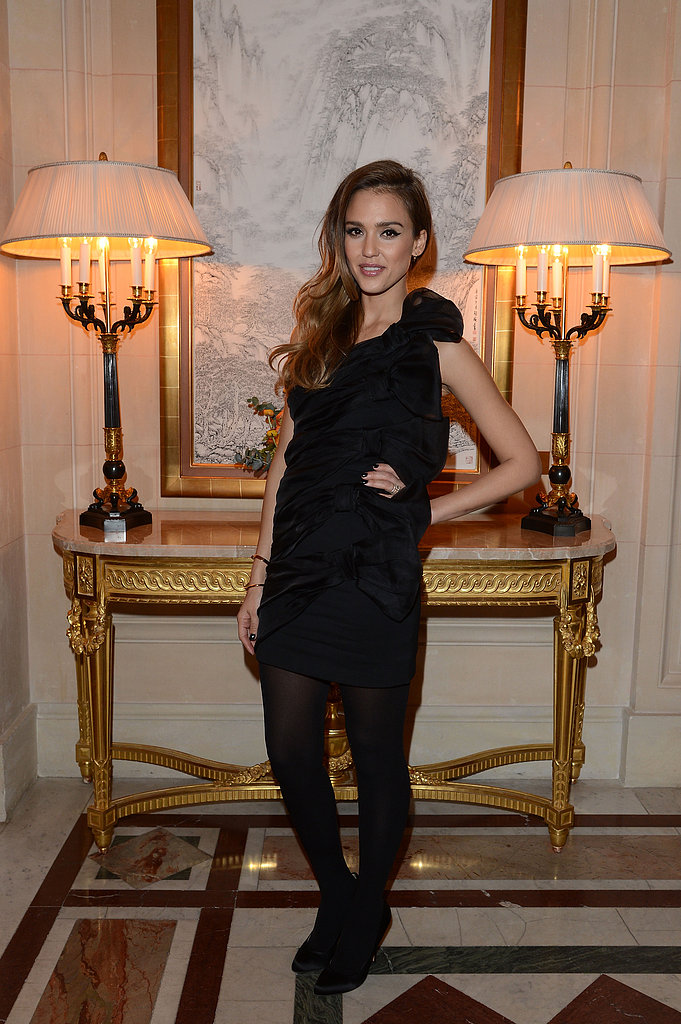 At the CR Fashion Book party, Jessica Alba looked girlie in a textured black minidress.