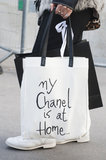 A black and white tote displayed a cheeky Chanel message.