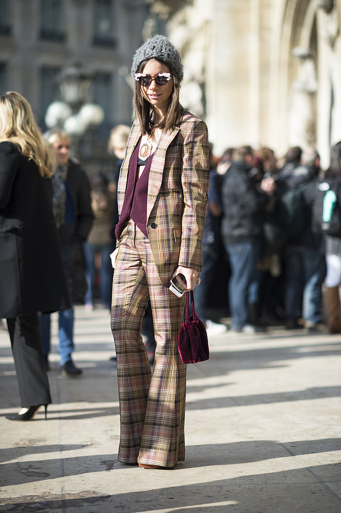 The plaid suit was just the starting point; this showgoer amped it up with statement shades, a beanie, and a sexy flash of skin. Source: Le 21ème | Adam Katz Sinding
