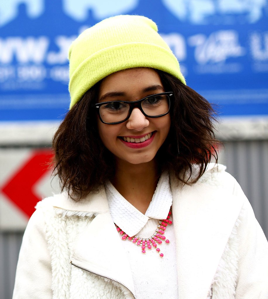 A neon yellow beanie and bright pink necklace injected a quirky touch against white separates.