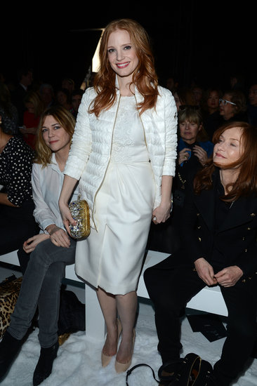 Jessica Chastain attended the Moncler Gamme Rouge show in a sophisticated white palette, finished with a sparky gold clutch and nude pumps.