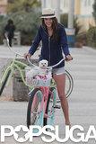 Alessandra Ambrosio rode a bike with her dog.