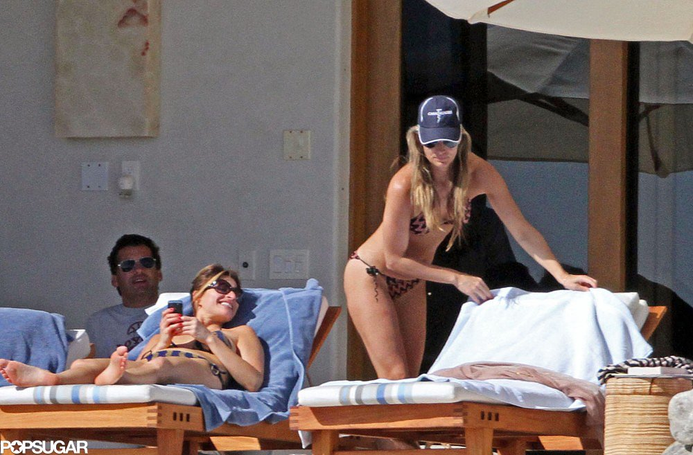 Molly Sims set up shop by the pool in Mexico in January 2011.