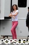 Miranda Kerr wore pink pants and a white t-shirt.