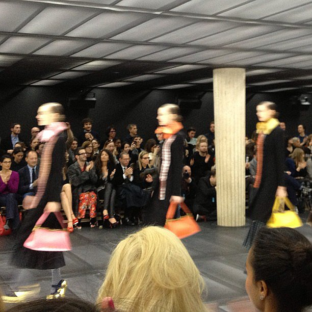 The Miu Miu show featured bright bags that popped against black coats.