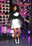 While performing at The Armory Party in NYC, Solange Knowles took her color palette in a mod direction via a metallic miniskirt, black turtleneck with an abstract print, and black-and-white peep-toe booties.