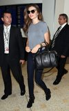 Miranda Kerr touched down in Sydney carrying her black Givenchy Lucrezia tote ($1,694) with a simple gray tee, true blue skinny jeans, lace-up booties, and tortoiseshell sunglasses.
