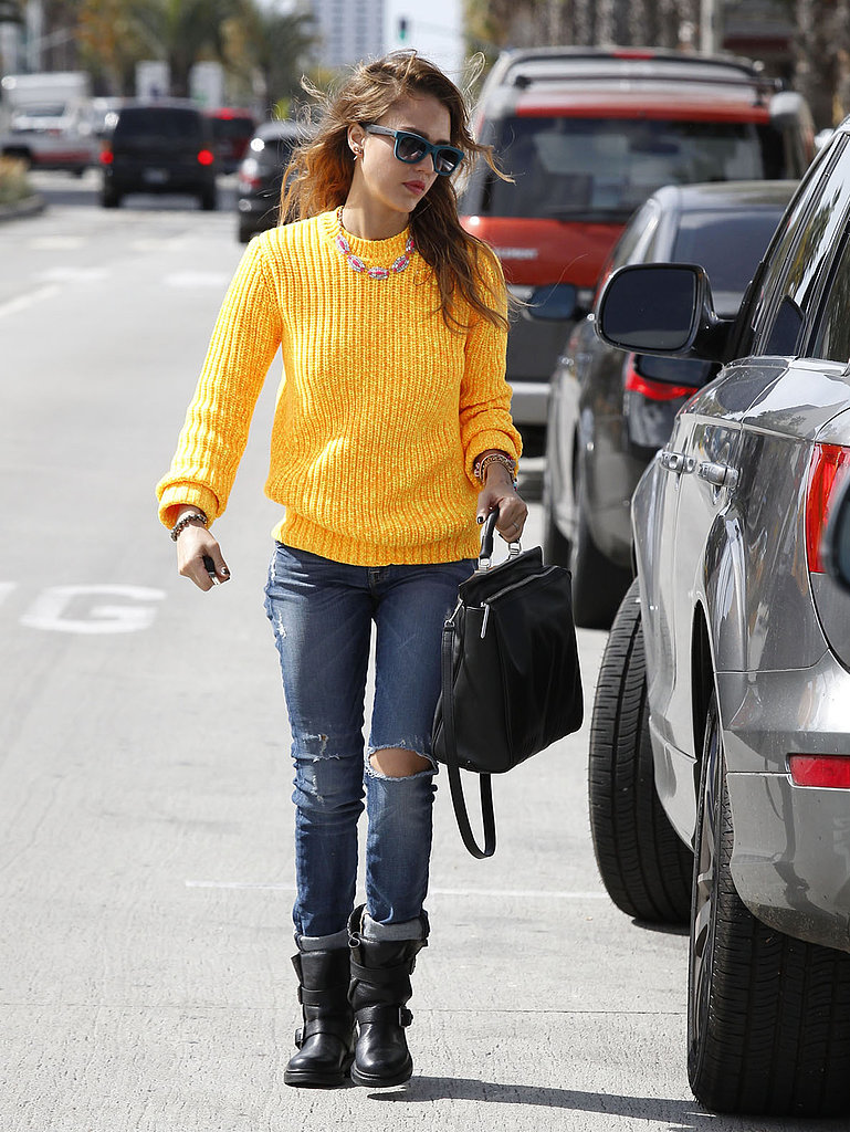 Behold, Jessica Alba works the perfect transitional outfit in Santa Monica, CA: a bright yellow sweater, ripped denim, colorful sunglasses, and chunky Zadig & Voltaire moto boots.