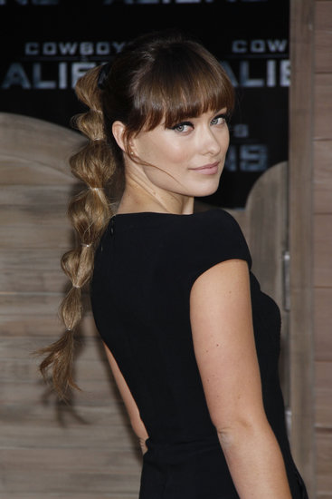 To update a simple high ponytail, Olivia added multiple rubber bands at the Cowboys & Aliens German premiere.