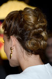 Her hair was twisted and twirled into a complex updo for the Butter premiere.