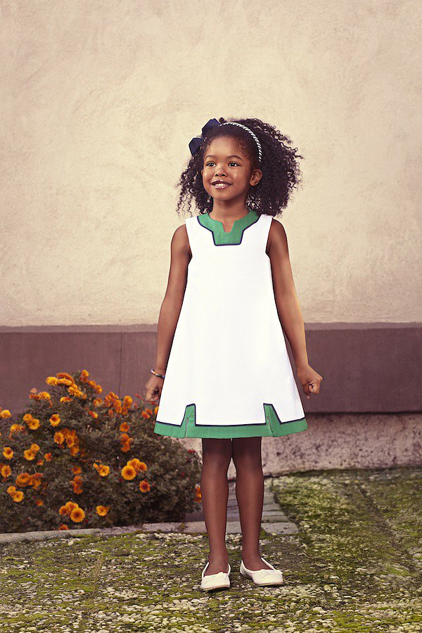 """Mimivail's Crisp White Pique Sundress ($125) is inspired by """"Bridget,"""" a 7-year-old Bostonian who lives for outdoor adventures with her older brother, Sam."""
