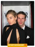 Jessica Hart and Stavros Niarchos posed in Vanity Fair's Oscars party photo booth.