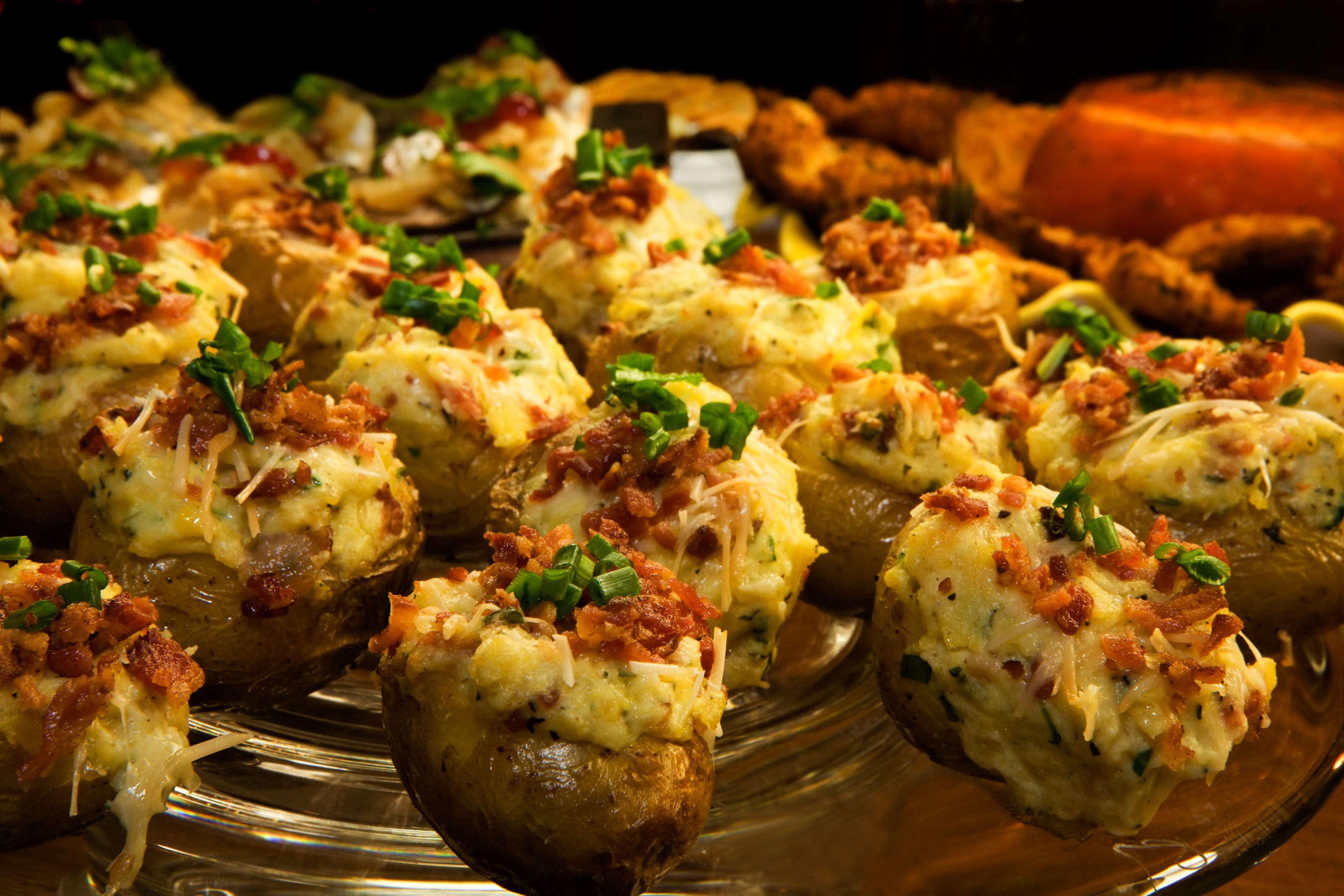 Loaded up with all sorts of goodies, twice-baked potatoes make for a ...